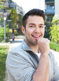 Attractive hispanic guy on outdoors laughing at camera Royalty Free Stock Photos