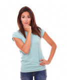 Attractive hispanic lady with pensive gesture Stock Photos