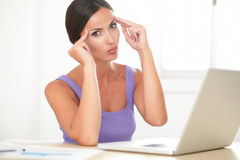 Attractive hispanic lady using her laptop Stock Image