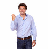 Attractive hispanic man celebrating a victory Royalty Free Stock Photos