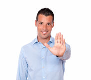 Attractive hispanic man with high gesture Royalty Free Stock Photos