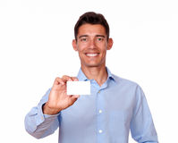 Attractive hispanic man holding a blank card Royalty Free Stock Photography