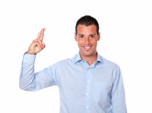 Attractive hispanic man with luck gesture Stock Images
