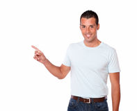 Attractive hispanic man pointing to his right Royalty Free Stock Photography