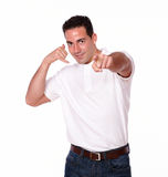 Attractive hispanic man with talk gesture Royalty Free Stock Image