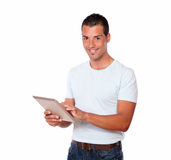 Attractive hispanic man using his tablet pc Stock Photos
