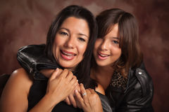 Attractive Hispanic Mother and Daughter Portrait stock images