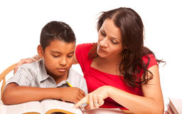 Attractive Hispanic Mother and Son Studying Stock Images