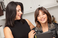 Attractive Hispanic Proud Mom & Pretty Daughter Royalty Free Stock Images