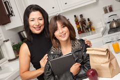 Attractive Hispanic Proud Mom & Pretty Daughter stock photos