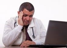 Attractive hispanic thirties male doctor headache. Attractive hispanic thirties medical man having headache Stock Photos