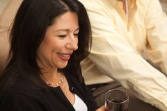 Attractive Hispanic Woman Enjoying Wine Royalty Free Stock Photos