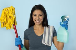 Attractive hispanic woman happy proud as home or hotel maid cle. Young attractive hispanic woman happy proud as home or hotel maid cleaning and housekeeping Stock Images