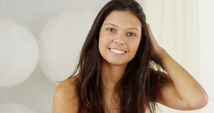 Attractive Hispanic woman playing with hair Royalty Free Stock Photo