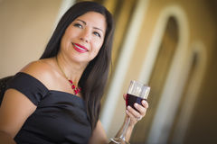 Attractive Hispanic Woman Portrait Outside Enjoying Wine Royalty Free Stock Images