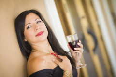 Attractive Hispanic Woman Portrait Outside Enjoying Wine Stock Images
