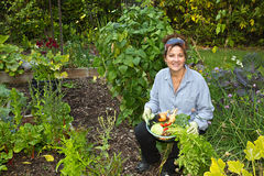 Attractive Home Gardener with vegetables