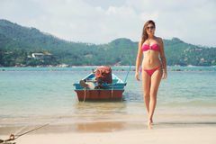 Attractive, hot, young lady with slim body walking out from the sea in Thailand Royalty Free Stock Photo