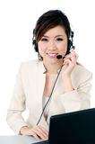 Attractive hotline operator with headset royalty free stock photo