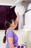 Attractive housewife doing the dishes Stock Image