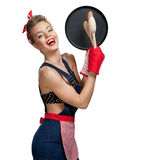 Attractive housewife wearing apron with kitchen utensils Stock Photography