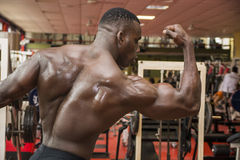 Attractive hunky black male bodybuilder in gym Royalty Free Stock Photo