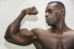 Attractive hunky black male bodybuilder posing Stock Photo