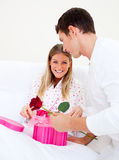 Attractive husband giving a present to his wife Royalty Free Stock Images