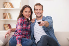 Attractive husband and wife are resting at home Stock Photography