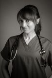 Attractive Indian doctor woman posing in a studio Stock Photo