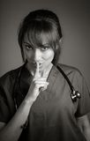 Attractive Indian doctor woman posing in a studio Royalty Free Stock Image