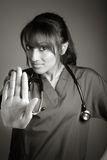 Attractive Indian doctor woman posing in a studio Stock Image