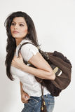 Attractive Indian girl holding hand bag Royalty Free Stock Image