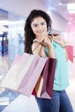 Attractive indian girl with shopping bags Royalty Free Stock Images