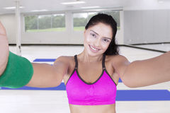 Attractive Indian woman taking selfie at gym Stock Photo