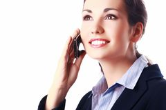 Attractive inspired businesswoman with cellphone. Attractive inspired businesswoman with mobile phone isolated against white background Stock Photos