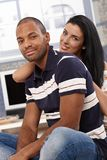 Attractive interracial couple smiling at home Royalty Free Stock Images