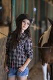 Attractive jockey at horse ranch Stock Photo