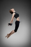 Attractive jumping woman dancer Stock Image