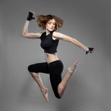 Attractive jumping woman dancer Stock Photo