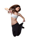 Attractive jumping woman on white Stock Photos