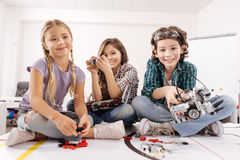 Attractive kids having fun in the science studio Stock Photos
