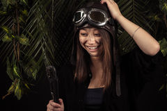 Attractive Korean girl laughing with adjustable wrench in hand Stock Photos