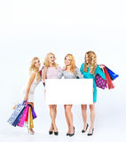 Attractive ladies during the seasonal sale royalty free stock image
