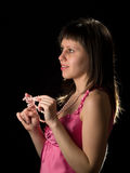 Attractive lady. In pink silk dress smiling Stock Photography
