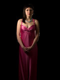 Attractive lady. In pink silk dress looking forward Stock Images