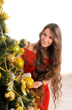 Attractive lady at christmas tree Stock Photography