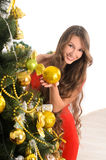 Attractive lady at christmas tree Royalty Free Stock Photos