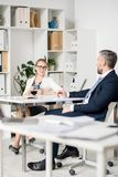 Attractive lady discussing future plans with colleague stock image