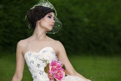 Attractive lady in formal gown in the park Royalty Free Stock Photo